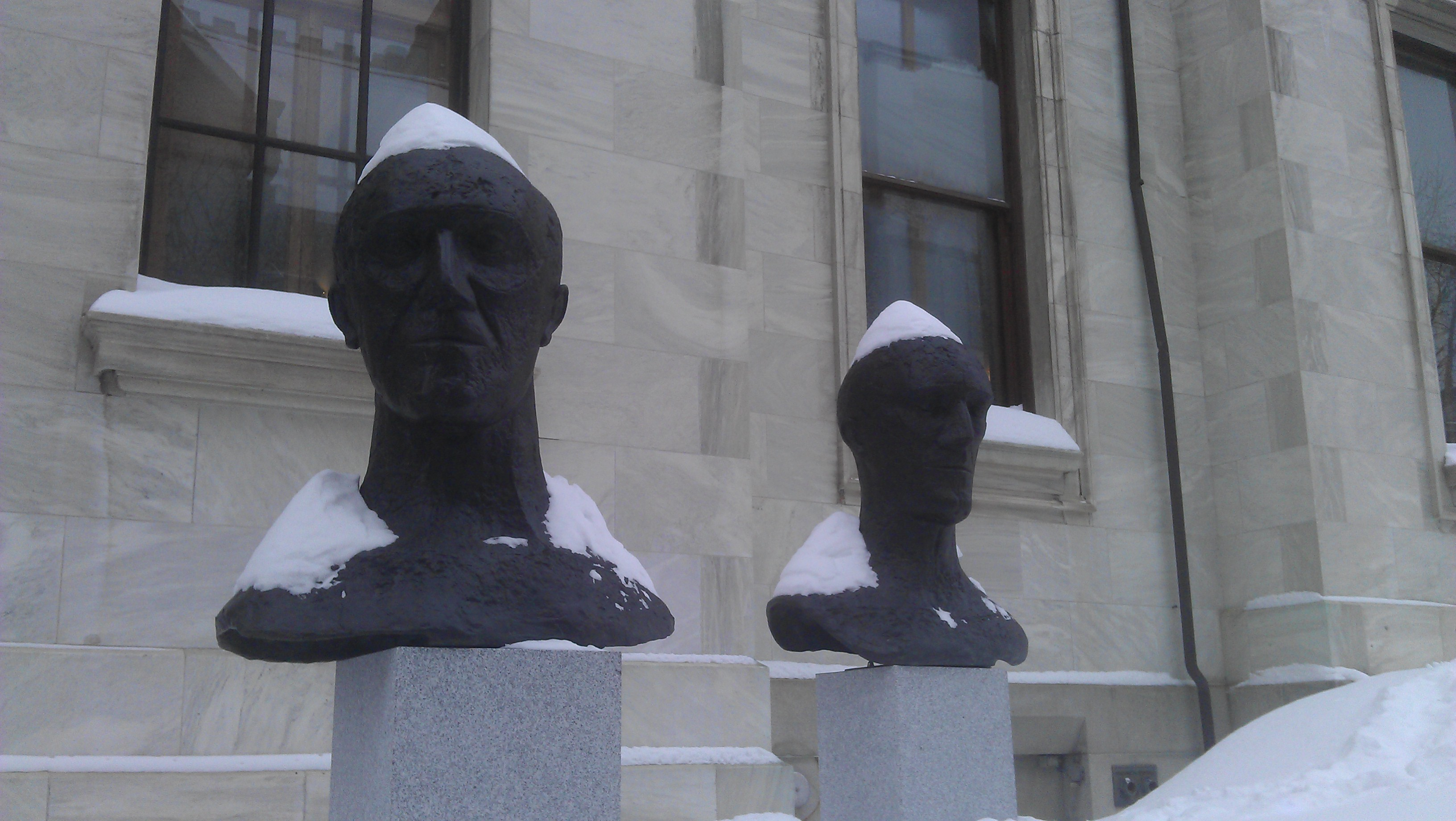 Statues wearing hats