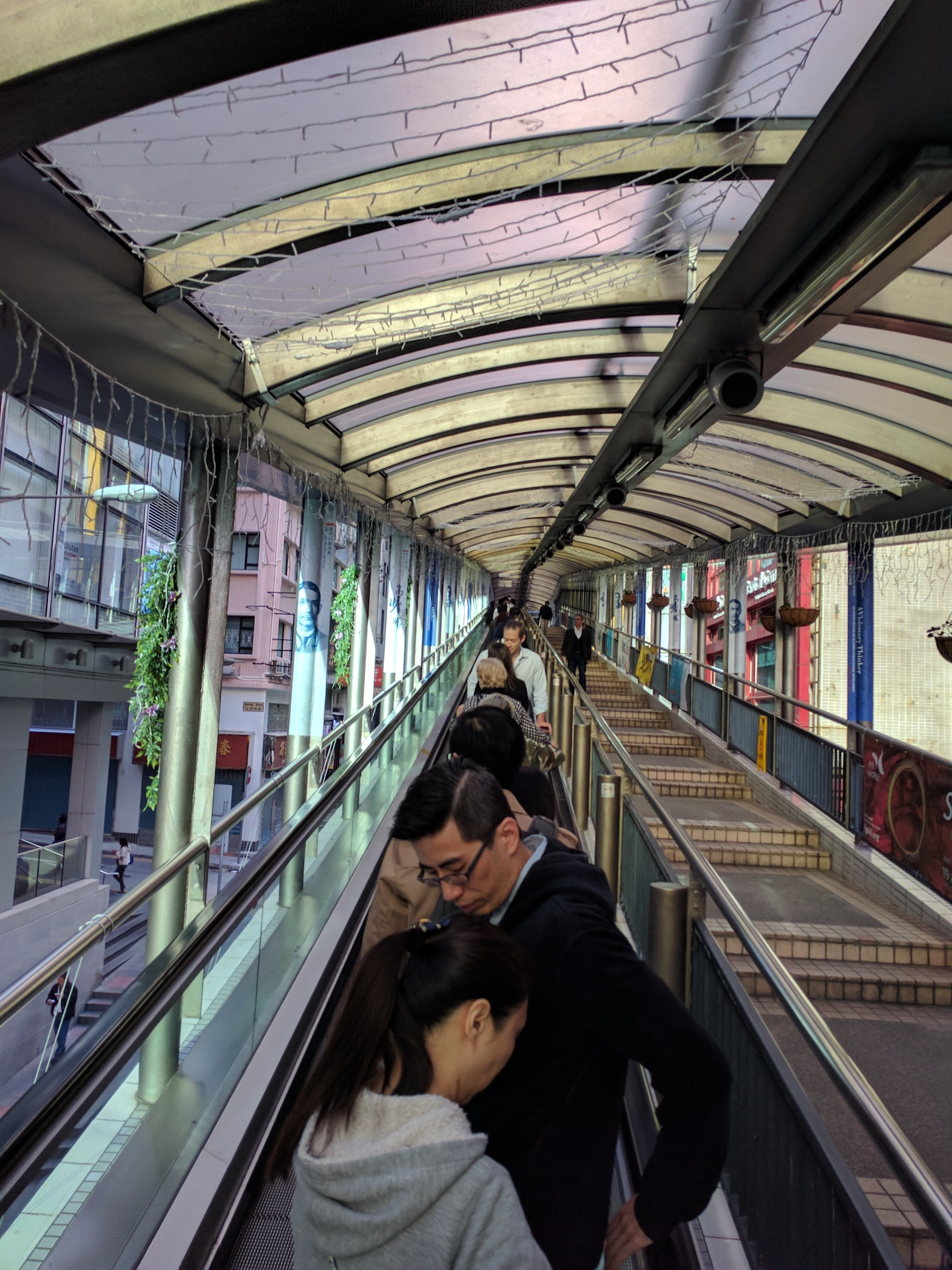 Hong Kong drives on the left, walks on the left, but stands on the right on escalators